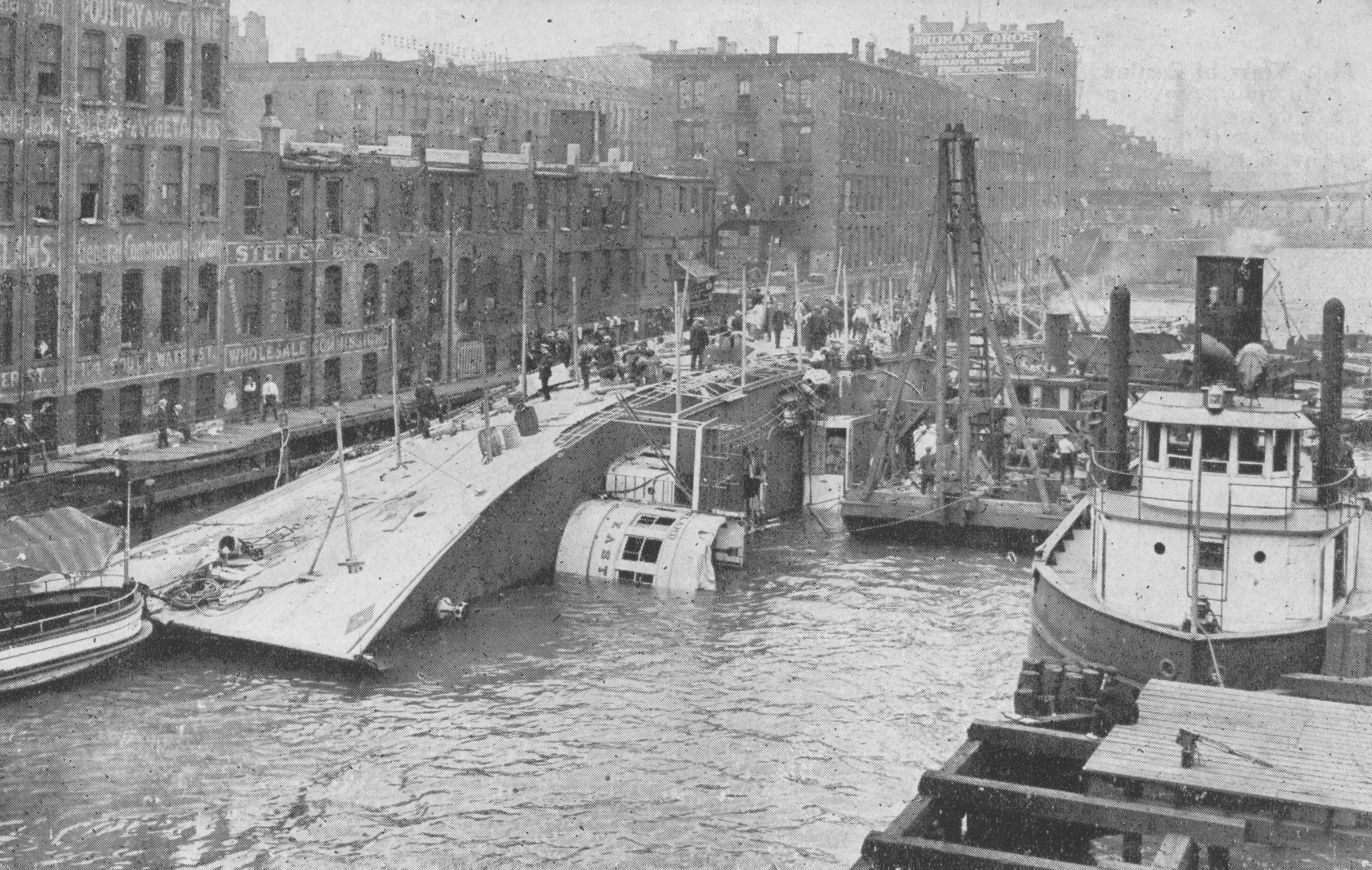 Picture of the Eastland resting on its side in the Chicago River