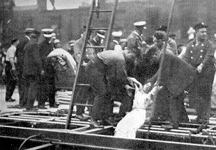 Body of woman pulled from the hull of the ship