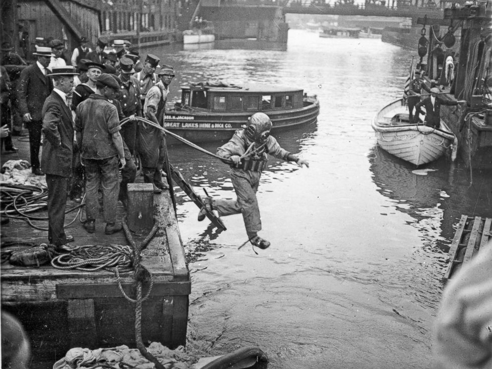 Rescue working jumping into the Chicago River