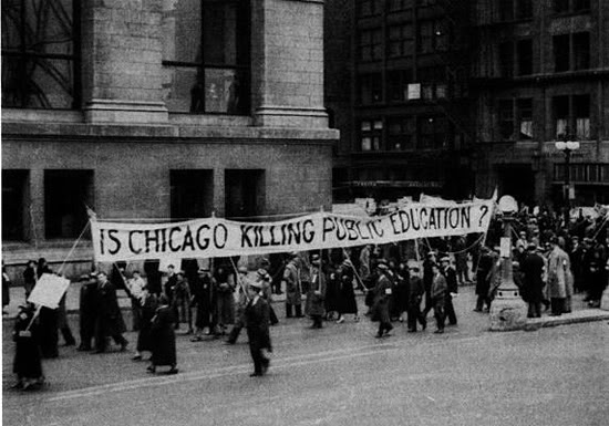 Chicago Teachers met in Grant Park before leading protest marches throughout the Loop, protesting pay cuts and the city's failure to pay teachers. By the time of this protest in March, 1933, many teachers were owed six-eight months of pay.