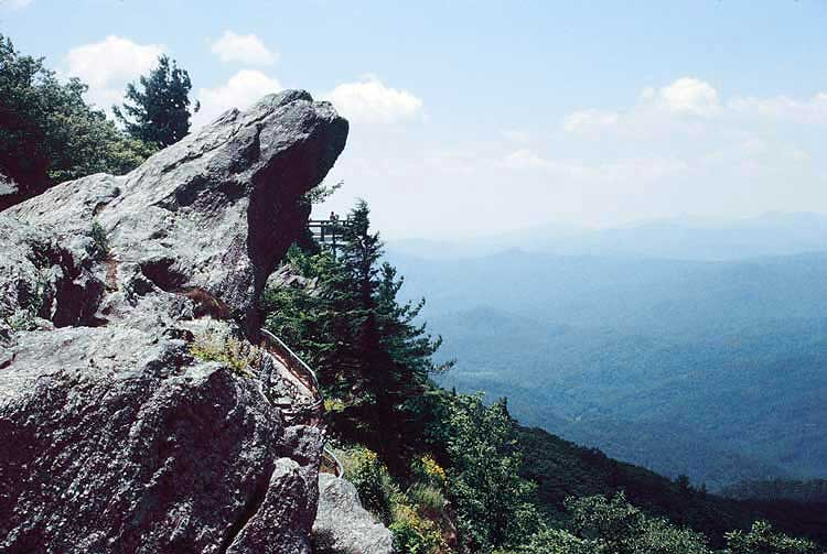 "The Blowing Rock is known around the world for the legend of two star-crossed lovers. Visitors to the formation can enjoy an incredible view from the ""Crown of the Blue Ridge"" from a nearby observation tower."