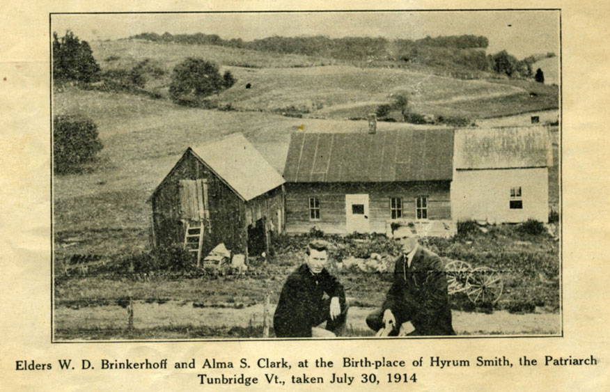 1914 photo of two LDS at the spot where Hyrum and Samuel Smith were born. Buildings in back are not of the original Smith farm, but built by the current occupants of the land at the time