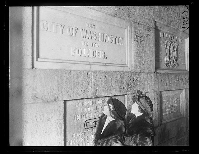 Visitors examine the City of Washington's memorial stone in the Washington Monument. Photo circa 1922, courtesy of the Library of Congress.