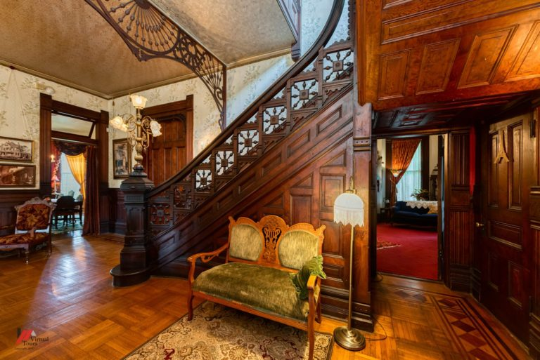 The interior features elaborate woodwork and antique furnishings.