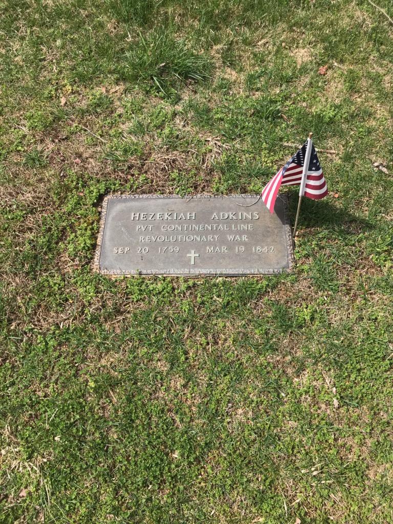 A plaque in Morrison Cemetery dedicated to Hezekiah Adkins.