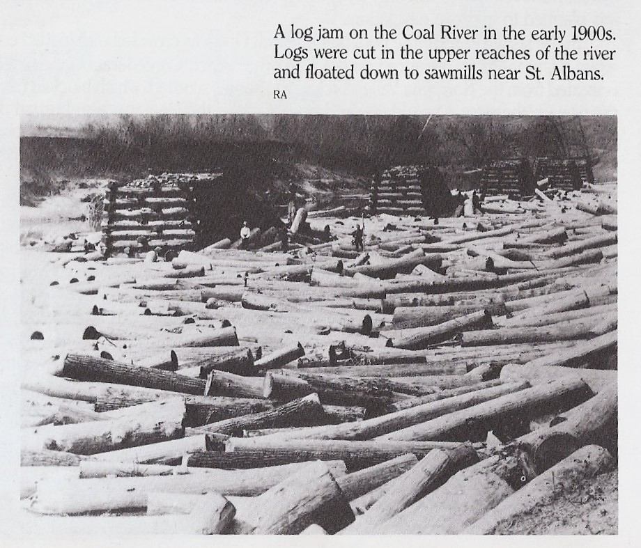 Photo of log jam on the Coal River.  Notice men on logs and log booms. Some of the log booms are still present today in the form of vegetation covered islands in the middle of the river.  Taken from Kanawha Valley Images, pg. 70.