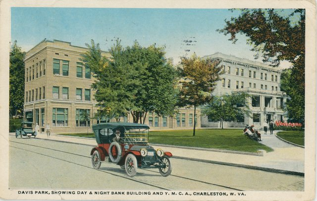 A postcard depicting Davis Park. The YMCA is the white building at right, later torn down in 1981.