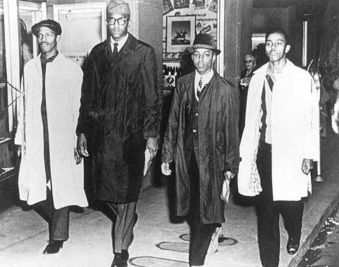 The A & T Four photographed outside of Woolworth following their first day of protesting segregation.