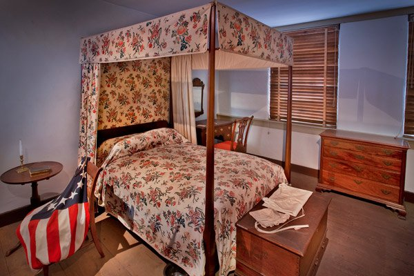Several of the rooms are furnished to resemble a typical Revolutionary era home.