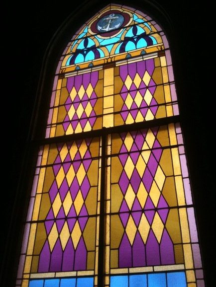 One of the many original stained glass pieces within the church.