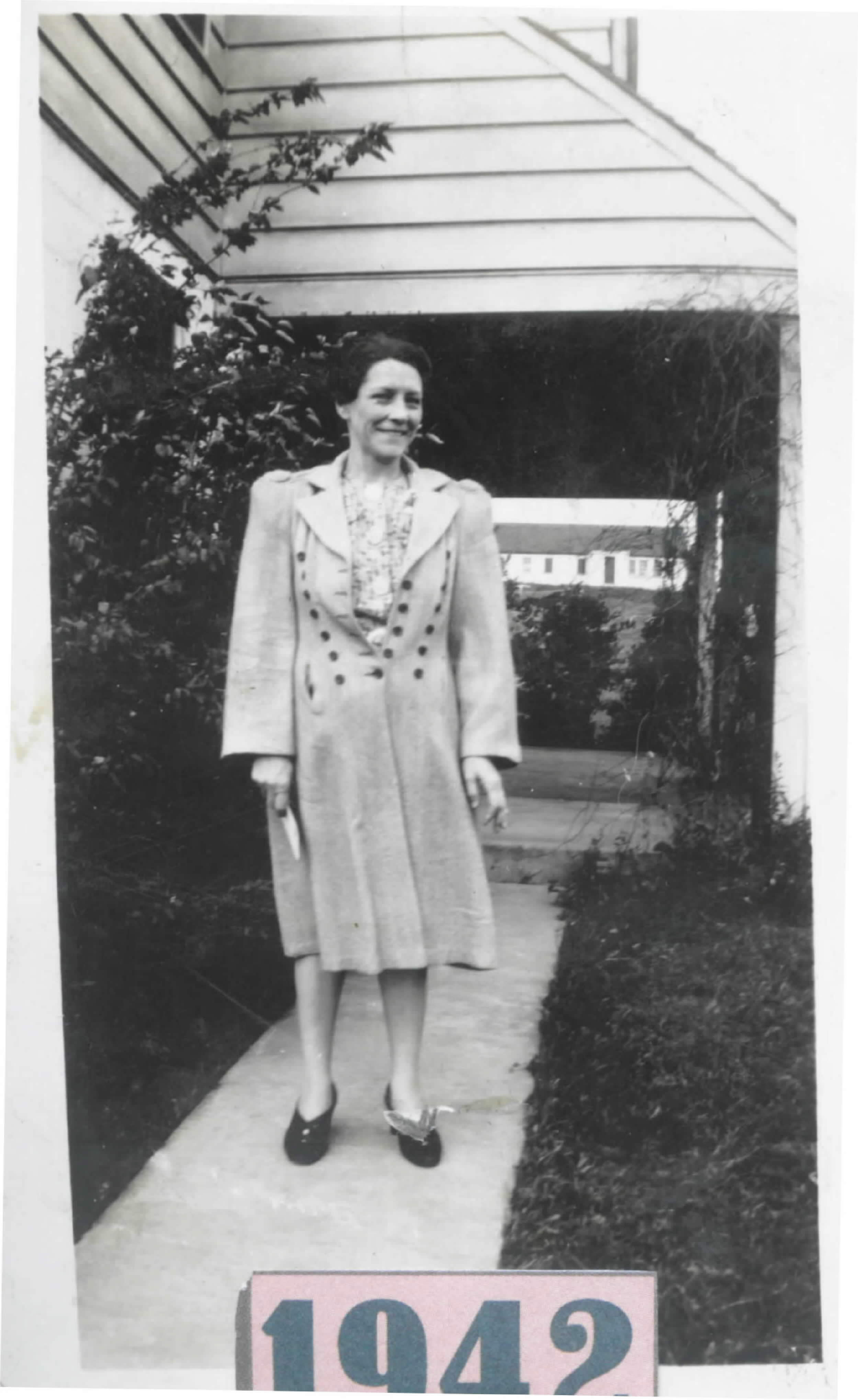 Ruth Heinz in front of E-15 porch in 1942