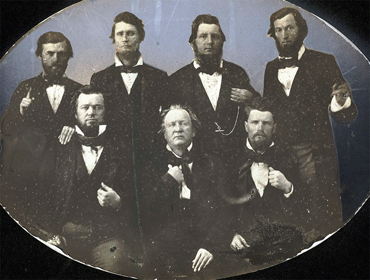 The seven convention delegates who opposed secession L to R standing; AP Schuford, James W Throckmorton, Lemuel H. Williams, and Joshua Johnson L to R seated; William H. Johnson, George W. Wright, and Thomas P. Hughes
