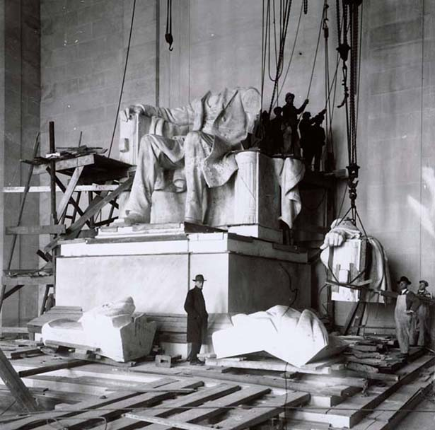 The Piccirilli Brothers, who carved the statue under the guidance of architect Daniel Chester French, stand at the unfinished statue of President Lincoln.