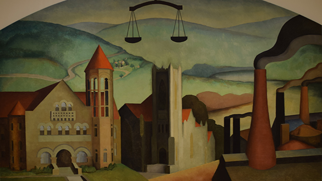 "Blanche Lazzell's ""Justice"" depicts scenes familiar to those who have visited Morgantown. Funded by the Public Works Art Project in the 1930s, the mural shows WVU's Stewart Hall, the First Methodist Episcopal Church, and glass factory smokestacks."