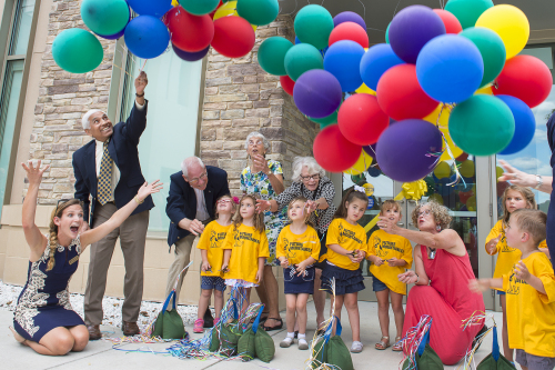 Museum Education, Heather Harris (far left, seated), and others release balloons in celebration of the museum's grand opening in the fall of 2015.