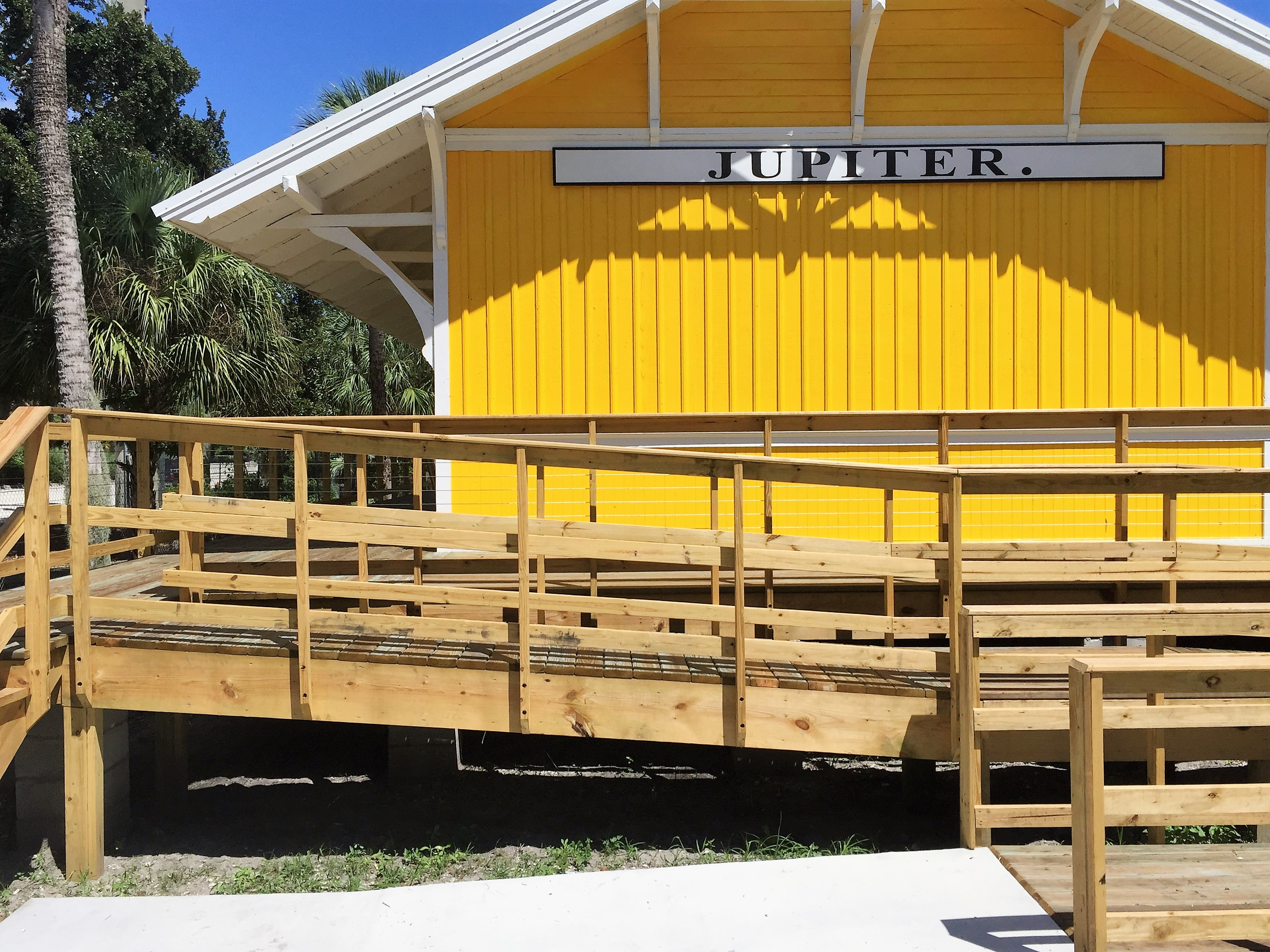 The Jupiter train depot is one of the few remaining wood frame stations built by the Florida East Coast Railroad.    Many of its depots were built from the same building plans and are only distinguishable by the large signs facing down the tracks. The f