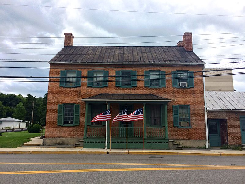Kerns House (also known as the American Legion Hampshire Post No. 91 Building) is a late 18th-century residential and commercial building at 154 East Main Street in Romney, West Virginia, United States. United States flags flying in front of the Kerns House on the thirteenth anniversary of the September 11, 2001 attacks. Photographed by Justin A. Wilcox of Washington, D.C.