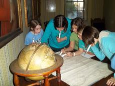 Young students learn what it is like to work at a museum at The Moffatt-Ladd House
