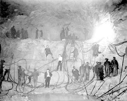 Miners working in the tunnel.