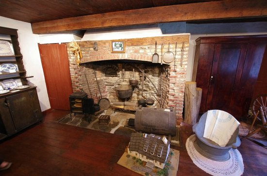 The kitchen features a large fireplace