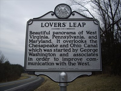 The historical marker is located along the road near the lodge where visitors can walk down and view Lovers' Leap.