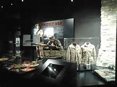 Museum exhibits include battle flags, uniforms, and weaponry.