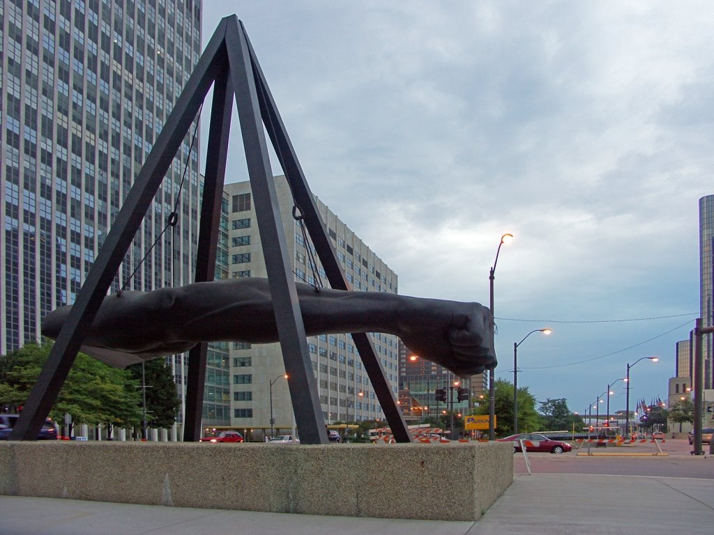 It represents the power of Joe Louis' punch both inside and outside the ring. Because of his efforts to fight Jim Crow laws, the fist was symbolically aimed toward racial injustice.