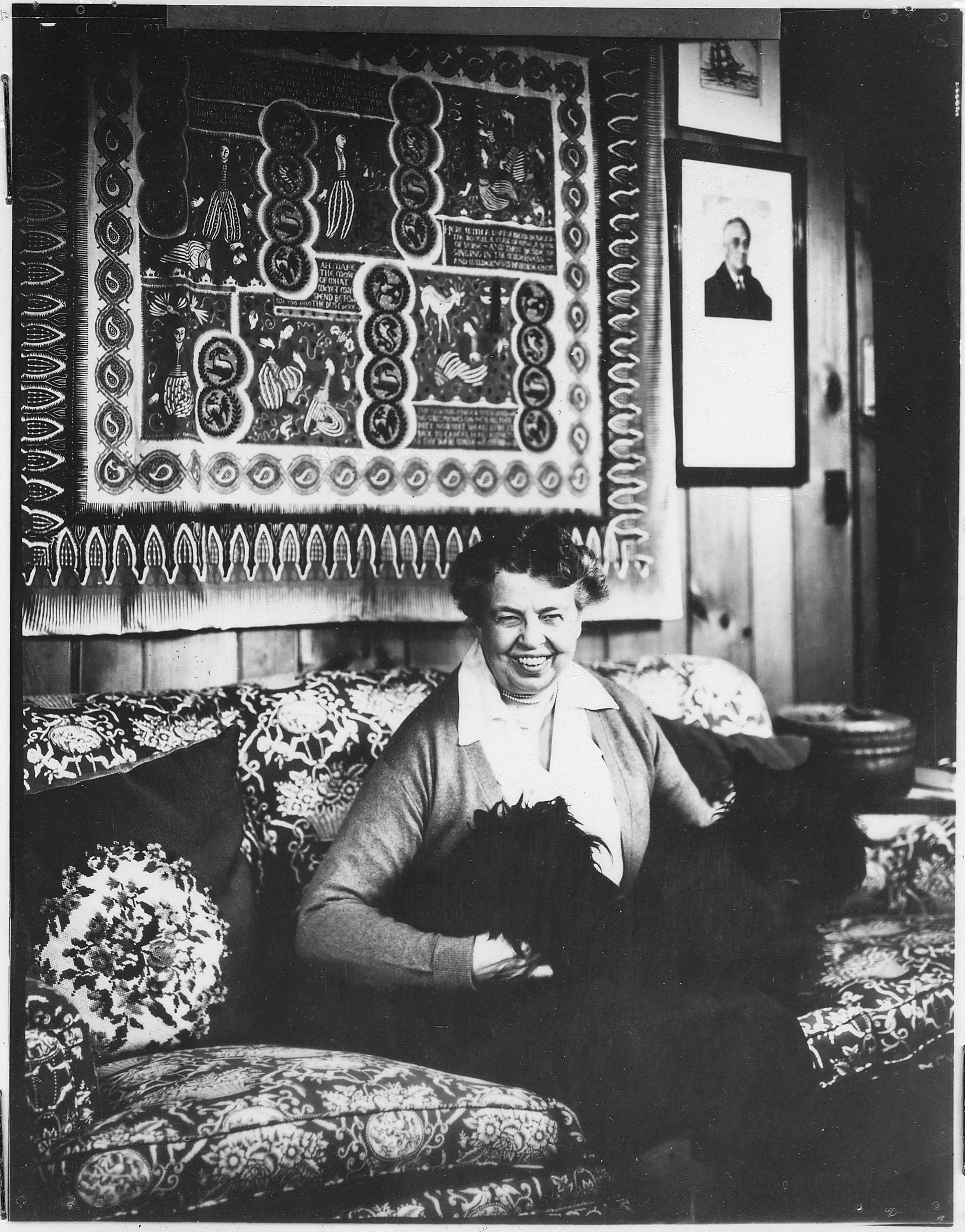 Eleanor Roosevelt posing with her two Scotties, Tamas and Fala, at Val-Kill in 1949