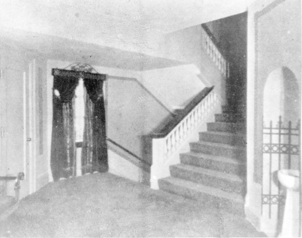 1926. The mezzanine area on the alley side of the theatre. Note the balusters on stairs, the window, and the water fountain.
