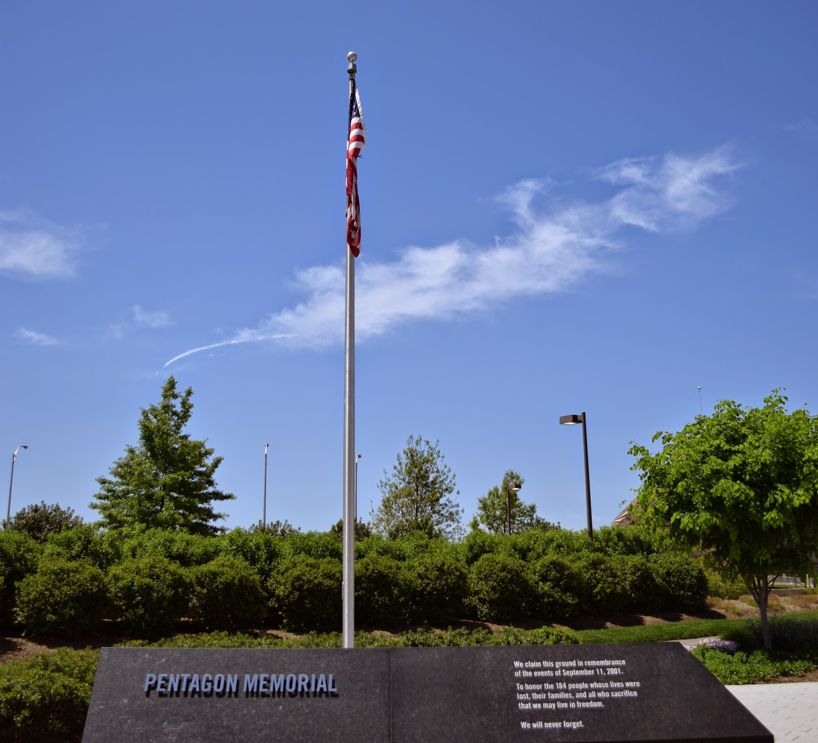 "Flag pole w/ an inscription that reads, ""We claim this ground in remembrance of the events of September 11, 2001. To honor the 184 people whose lives were lost, their families, and all who sacrifice that we may live in freedom. We will never forget."""