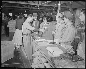 The block 30 co-op store and Japanese customers; 1940s.