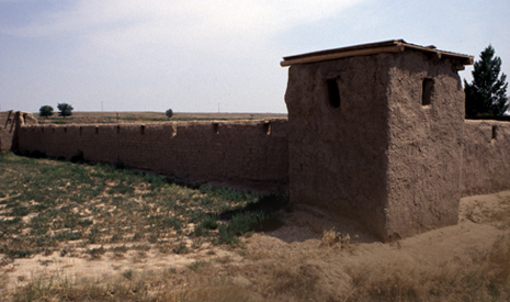 Closer image of the reconstructed adobe replica of Fort Vasquez.  A tower on the adobe.