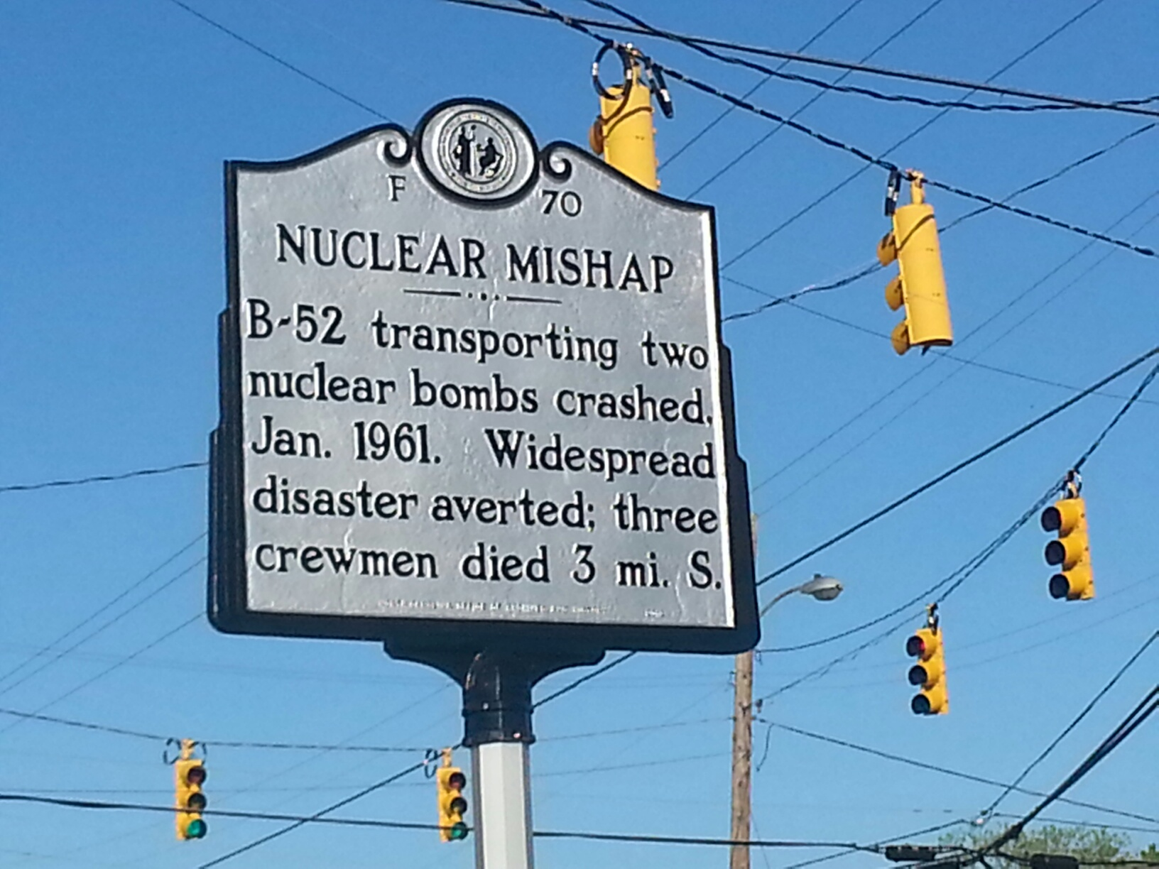 The historic marker is located in the center of town where more people might read it. The crash site is located three miles north of the sign.