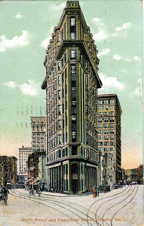 A historic postcard of the Flatiron Building