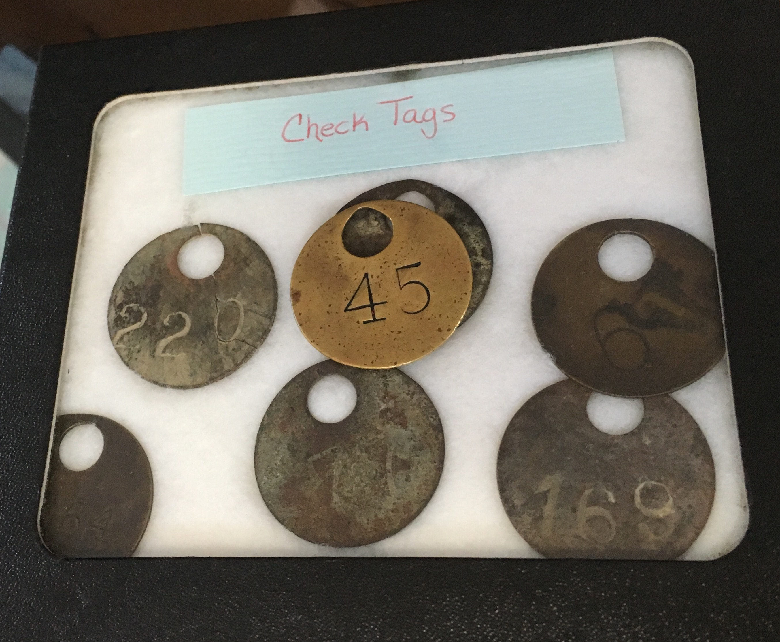 Check tags. These tags were used to identify the miners by a number. 