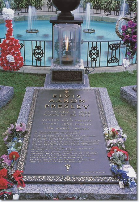 The grave of Elvis Presley located on the south side of the pool at Graceland. An eternal flame is lit at the head of Elvis' grave.