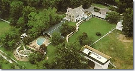 A birds eye view of the mansion showing the lavish design and pool.