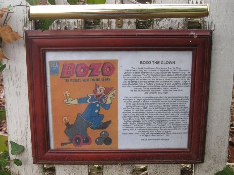 This sign about the history of Bozo the Clown can be found on the white picket fence in the side yard.