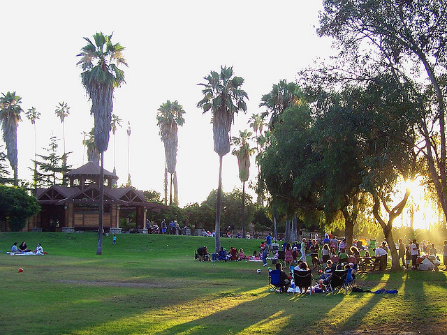 People gather at the lawn surrounding the park's amphitheater.
