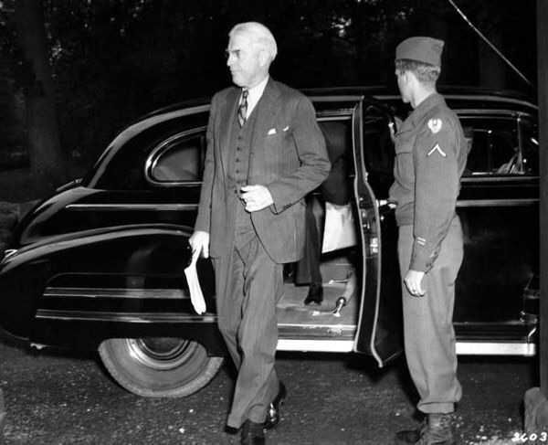 Clayton in 1945 arriving for the Potsdam Conference, at which the terms for the ending of WWII were negotiated