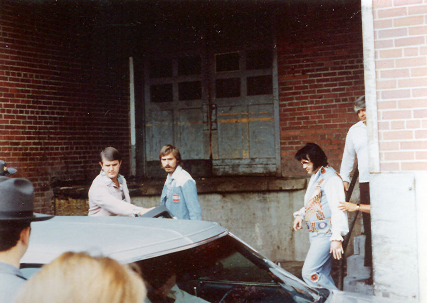 Elvis Presley exiting the Daniel Boone Hotel to perform a concert at the Charleston Civic Center on July 24, 1976.