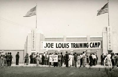 The banner on the stadium announcing the fighter's training in Kenosha.