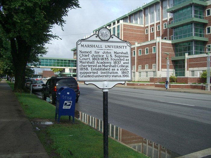 This historic marker is located on south side of 3rd Avenue, just past Harris Hall when walking east.