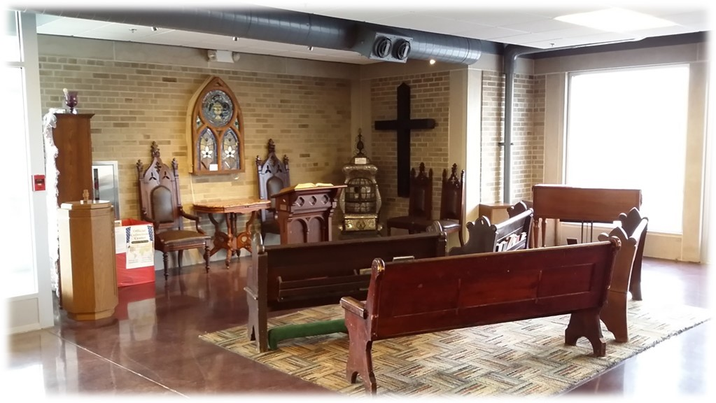 A chapel composed of furniture and artifacts from local churches.