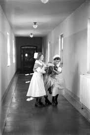 Nurses holding a patient.