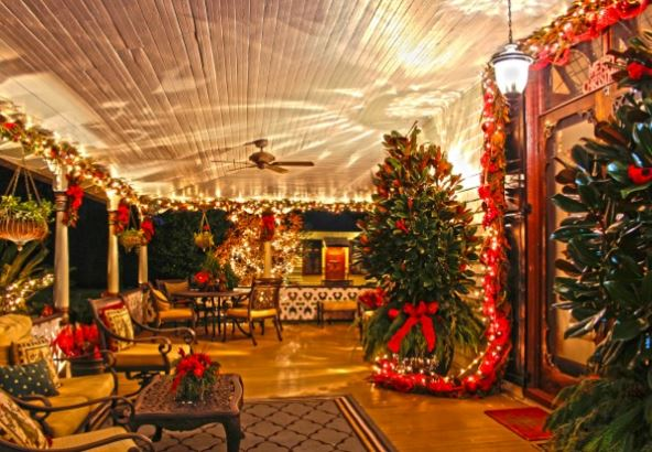 The mansion's porch decorated for Christmas.