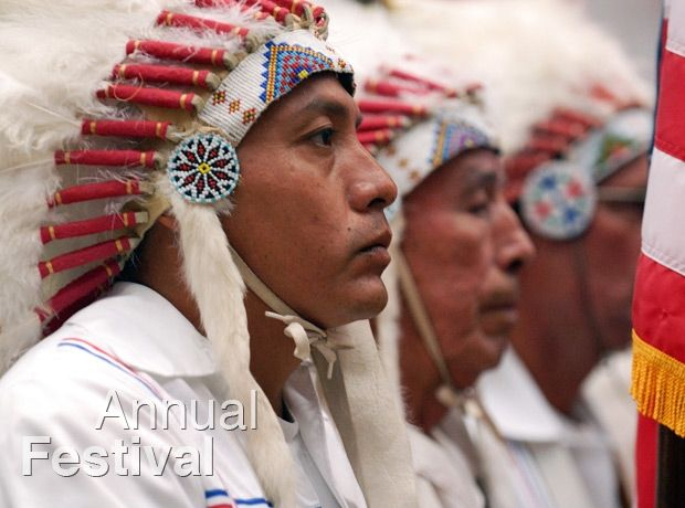 Picture of Native Americans in traditional clothing at the annual festival.