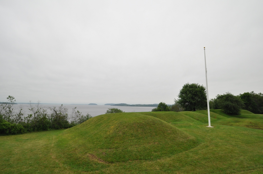 The remains of Fort Machias where canons were once located. The remains of Fort O'Brien are to the left and are obscured by bushes. The naval battle took place in the waters offshore.