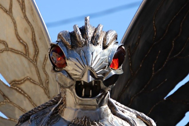 The face of the Mothman statue.