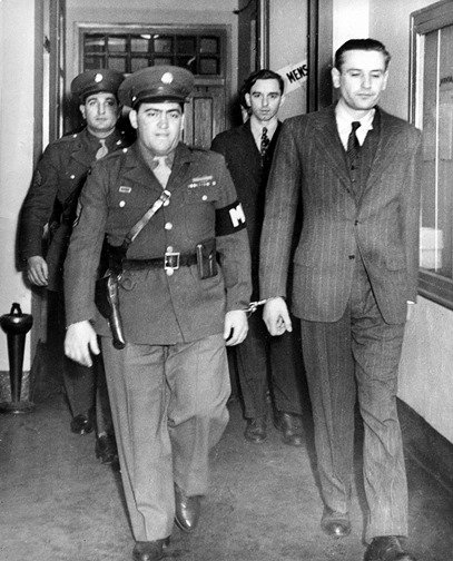 Gimpel (front R.) and Colepaugh (rear R.) escorted to trial by military authorities. The original death sentence was commuted to life in prison by President Truman. Both men were released far sooner. (Associated Press).